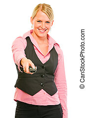 Happy modern business woman with TV remote control in hand