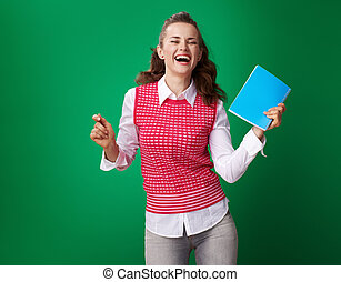 happy modern student woman with blue notebook dancing
