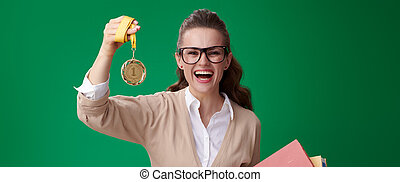 happy modern student woman with books showing medal