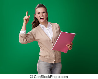 happy modern student woman with pink notebook got idea