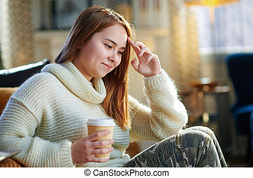 happy modern teen girl with cup of hot beverage