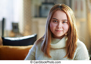 happy modern teenager girl at modern home in sunny winter day