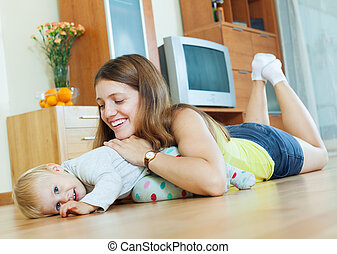 mom and child on wooden floor