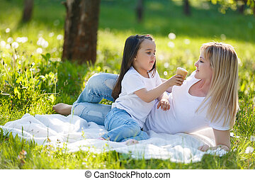 Happy mom and daughter. Walk in the green park