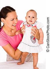 happy mom holds  baby
