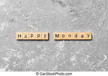 Happy monday word written on wood block. Happy monday text on cement table for your desing, concept