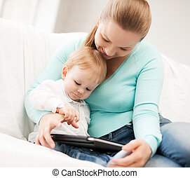 mother and adorable baby with tablet pc - happy mother and ...