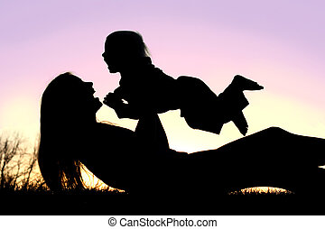 Happy Mother and Baby Playing Outside Silhouette