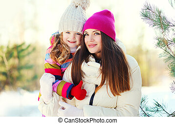 Happy mother and child together in winter day