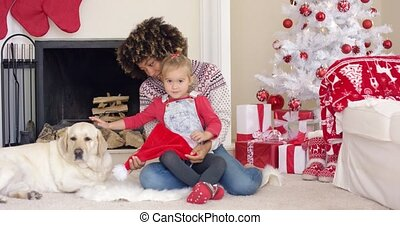 Happy mother and child with dog on Christmas Day - Happy...