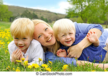 Happy Mother and Children Playing Outside