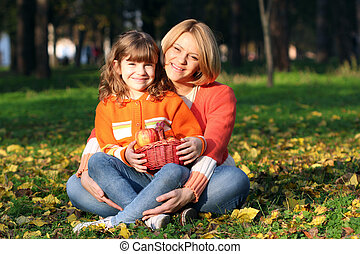 happy mother and daughter in park