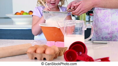 Happy mother and daughter making a