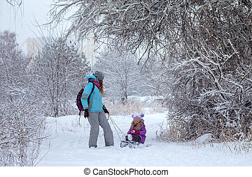 happy mother and daughter on a winter walk