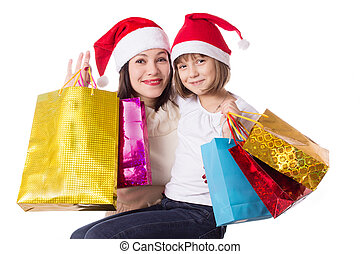 Happy mother and daughter on Christmas shopping isolated on...
