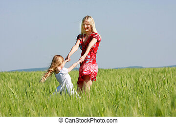 happy mother and daughter outdoors