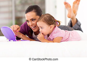 happy mother and daughter playing