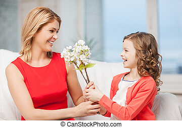 happy mother and daughter with flowers