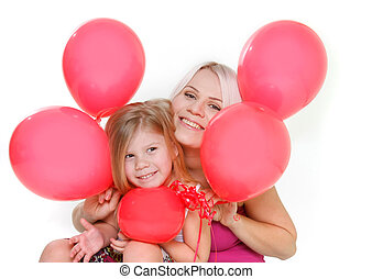 happy mother and daughter with red balloons over white