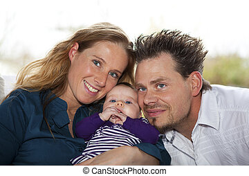 happy mother and father with baby