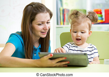 happy mother and her child with tablet pc