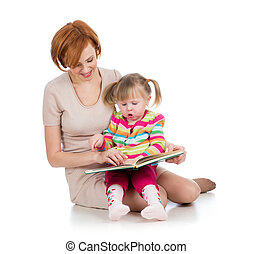 happy mother and kid girl reading a book together