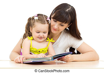 happy mother and kid read a book together