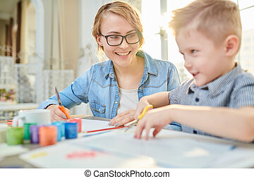 Happy Mother and Son Crafting Together