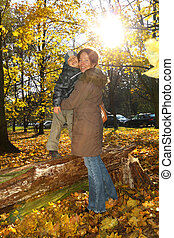 Happy mother and son in the park