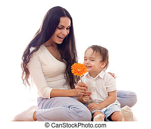 Happy mother and son with flower together isolated on white