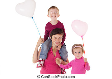 Happy mother and two children with balloons