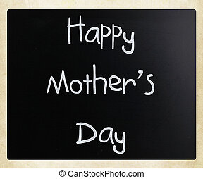 """""""Happy Mother Day"""" handwritten with white chalk on a blackboard"""