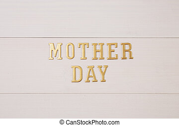 Happy mother day with gold text on wooden table, feeling romantic and care with decoration, word and alphabet mother day in festive with sign on desk, congratulation, top view, holiday concept.