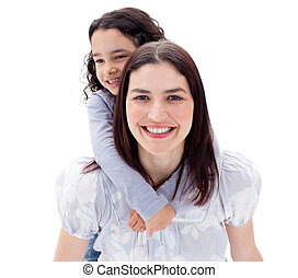 Happy mother giving her daughter piggyback ride