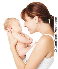 Happy mother holding newborn baby over white background