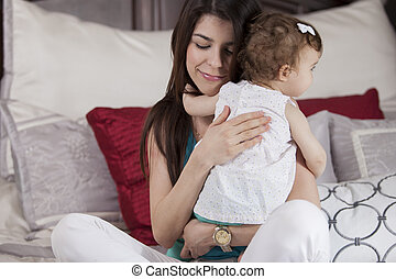 Happy mother hugging her baby