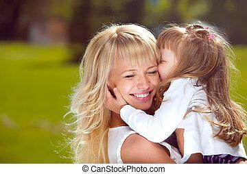 Happy mother hugging her daughter