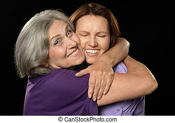 Happy mother hugging her daughter