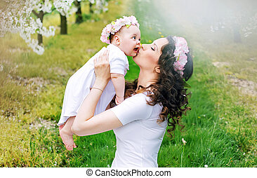 Happy mother kissing her little princess
