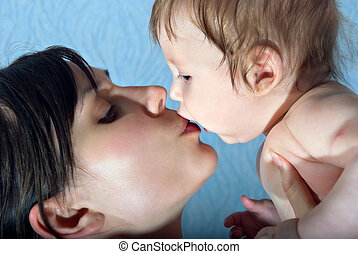 Happy mother kissing the baby