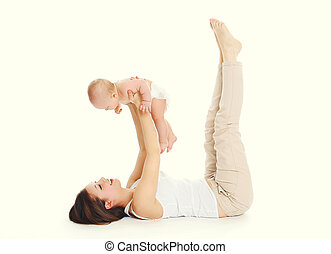 Happy mother playing with baby on a white background