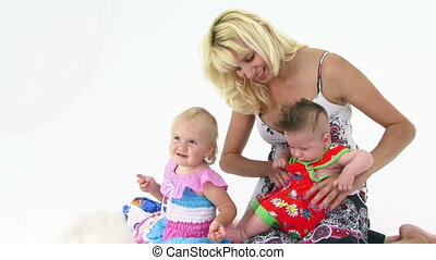 Happy Mother Playing With Two Small Children