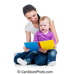 happy mother reading a book to child girl
