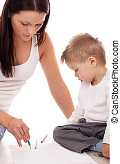 Happy mother with a child drawing a picture