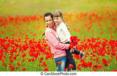 happy mother with a child in a field