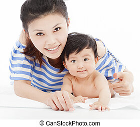 Happy  mother with adorable child baby boy