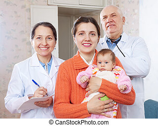 happy mother with baby and doctors