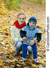 mother with boy in autumn