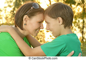 Mother with boy in summer park
