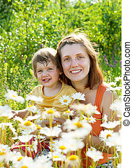 Happy mother with daughter in summer
